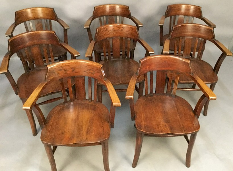 A Set of 8 Captains Chairs in Oak