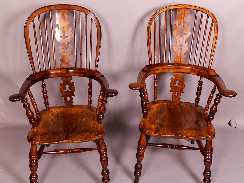 A Near Matching Pair of Yew Wood High Broad Arm Windsor chairs