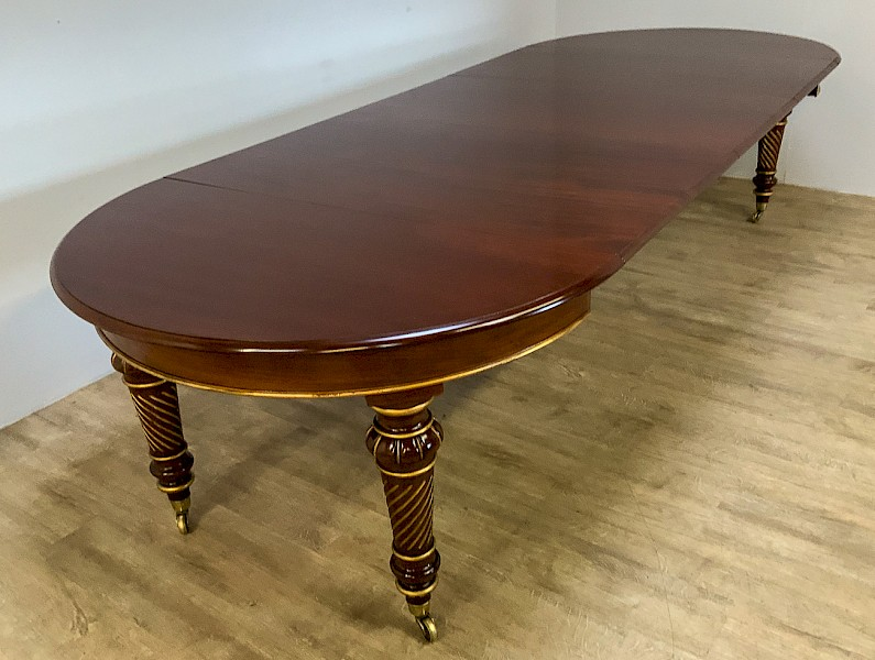 A Victorian Mahogany Dining Table with 3 leaves parcel gilt Harrods