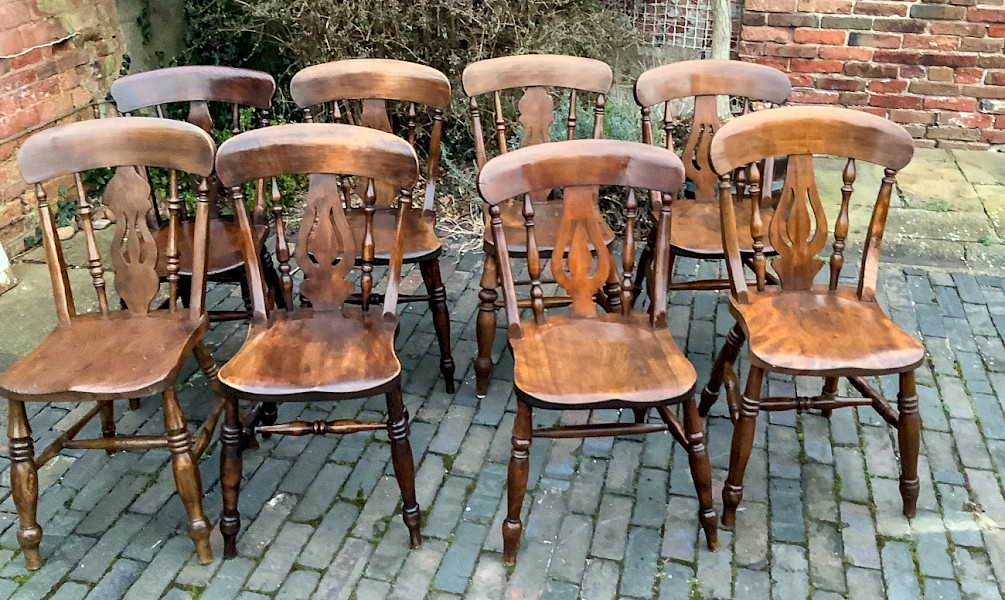 A Harlequin set of 8 fiddle back Kitchen Chairs