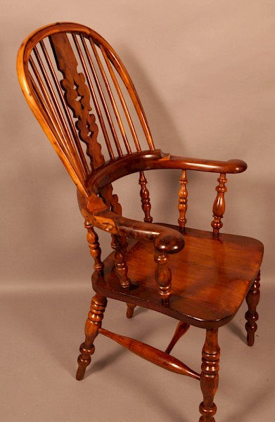 A Yew Wood Broad Arm Windsor chair Allsop Worksop